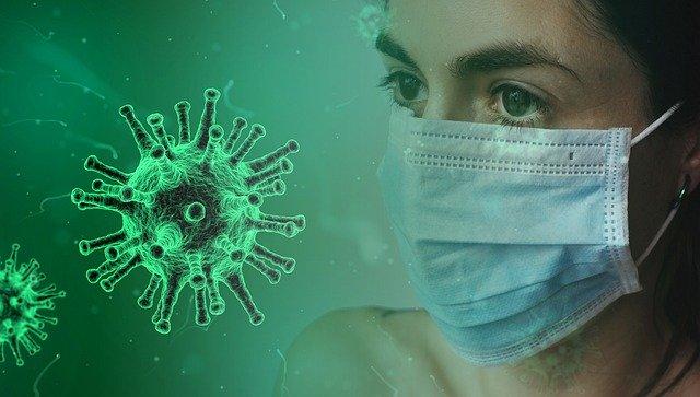 obrazek pani w maseczce, obok ikona wirusa